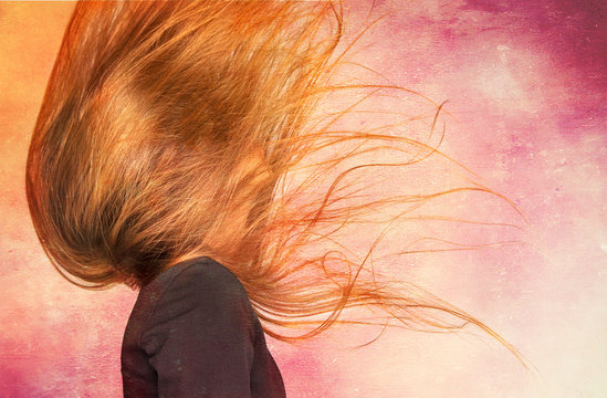Young Woman Flipping Long Brown Hair against painted background.