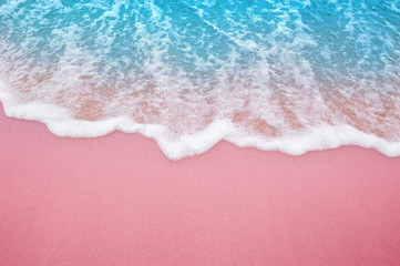 Wall Mural - Summer pink sands beach with soft blue ocean wave and beautiful fine sand pink color