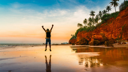 Happy summer lifestyle man traveler jump on Red Cliff beach Bang Saphan Noi, Active tourist male joy fun travel Prachuap Khiri Khan Thailand vacation trips, Tourism beautiful destinations place Asia