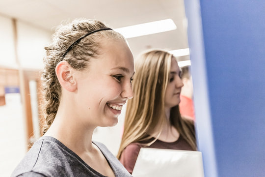 School kids hanging out in the hallway and at the lockers of their school. Red Lodge, Montana, USA