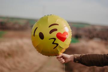 girl with balloon emoji