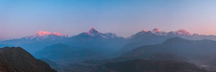 Sunrise panoramic view from Sarangkot Hill with Himalayan Mountains in background such as Annapurna, Hiunchuli, Kangshar Kang (Roc Noir), Mardi Himal, Machapuchare and Lamjung Himal, Pokhara, Nepal