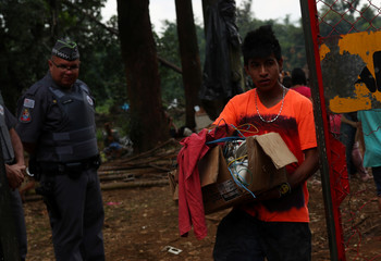 Guarani Mbya indigenous leave an area they occupied as a protest against tree cutting and the construction of an apartment complex near Jaragua indigenous land, after an eviction order, in Sao Paulo