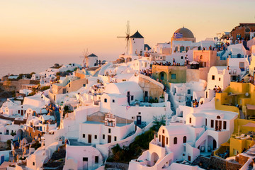Foto auf Leinwand Santorini Santorini Oia village during sunset whit luxury hotels and whitewashed buildings in Santorini Island a luxury vacation destination in Greece