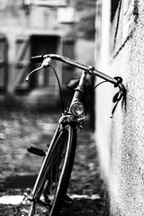 Foto op Canvas Fiets bicycle on a fence