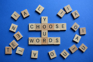 Choose Your Words, surrounded by random letters on blue background