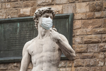 The Statue Of David in the Piazza della Signoria In Italy Wearing a Protective Face Mask