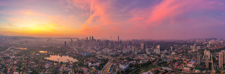 Aerial panorama cityscape view in the middle of Kuala Lumpur city center during sunrise, Malaysia Wall mural