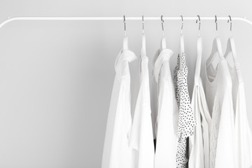 Wall Mural - White clothes hanging on a rack