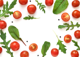 Fototapete - Vegetable frame with place for text: cherry tomatoes, lettuce, chard, mizuna, top view. Vegetables isolated on a white background.
