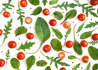 Fototapete - Creative flat layout of cherry tomatoes, lettuce, chard, mizuna, top view. Vegetables isolated on a white background.