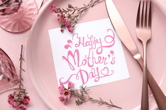 Table setting with card for Mother's day dinner, closeup