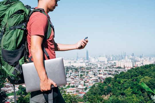 Digital nomad man traveling the world working with smartphone