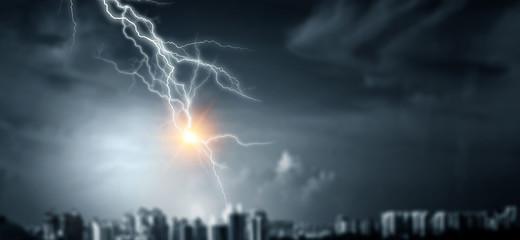 Lightning bolt at a dark night Fotobehang