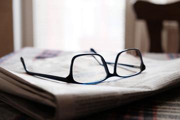 glasses on a newspaper  Fototapete