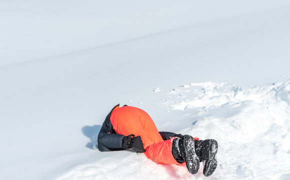 girl landing with her head on the fresh snow