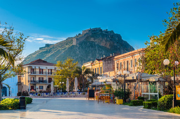 Nafplio Greece- Philellinon square-The historic square of the city located in the old town.The castle of Palamidi in the background.