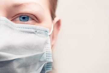 Masked caucasian woman face with copy space : pandemic concept and flu epidemic