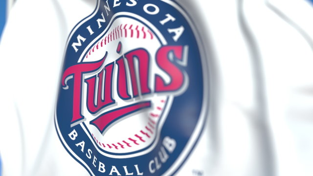 Waving flag with Minnesota Twins team logo, close-up. Editorial 3D rendering