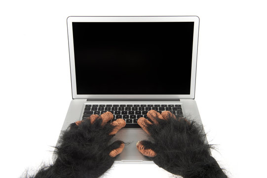 Hairy beast hands of an Internet troll typing on laptop computer with blank screen on white background