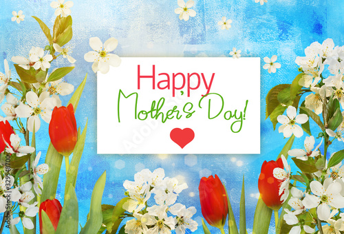Happy mother's day greeting card with red tulips and cherry flowers, bokeh on blue background