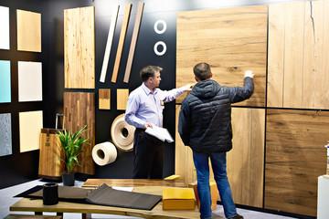 Men in shop of wooden panels