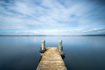 Long exposure landscape. Pier on the lake.
