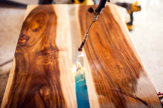 Treatment of wood with epoxy and varnish. manufacturing of furniture from solid