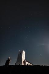 Fotobehang Kasteel Moonlit with stars Ballintoy Church, Causeway Coast and Glens, County Antrim, Northern Ireland