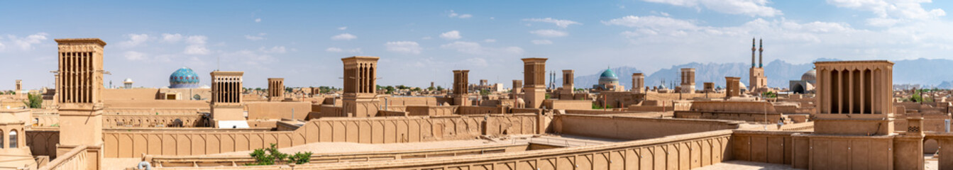 Fotobehang Oude gebouw Yazd cityscape with old brick buildings and badgirs wind catching towers in Yazd, Iran.