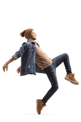 Young male dancer in casual clothes dancing