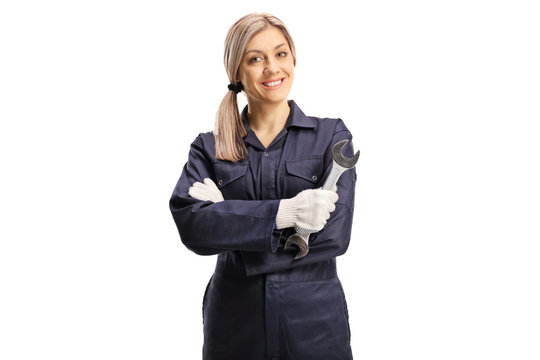 Young repair woman holding a wrench