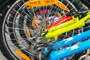 Lots of bicycle wheels in a bike shop