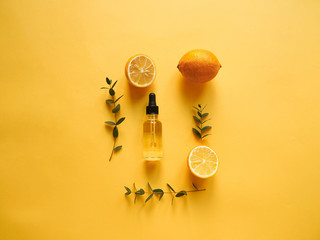bright flatlay composition with oil, citrus and eucalyptus. on yellow background. Concept beauty natural vitamin cosmetic product, skin care, top view Fotomurales