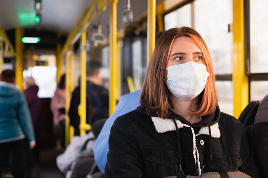 Young adult commutes in a protective face mask. Coronavirus, COVID-19 spread prevention concept, responsible social behaviour of a citizen