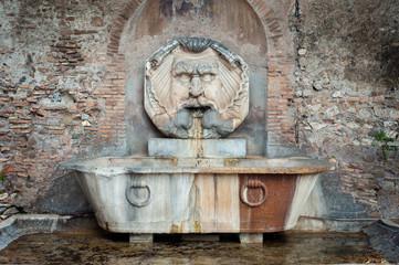 Fountain of the Mask (Fontana Del Mascherone) by Giacomo della Porta (1532-1602) in the Piazza Pietro d'Illiria on the Aventine Hill, Rome