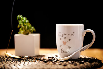 Foto op Canvas Cafe White ceramic cup with the words