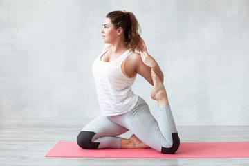 Lovely woman doing yoga exercise