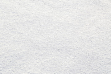 Fresh snow background - close-up of clean, rough snow texture