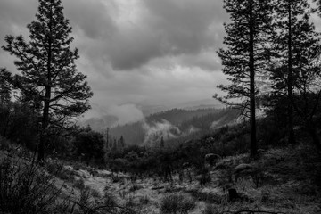 Wall Murals Gray traffic Yosemite Hills with clouds rolling through