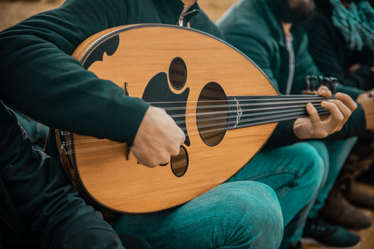 Arabic musician plays music on Oud traditional instrument