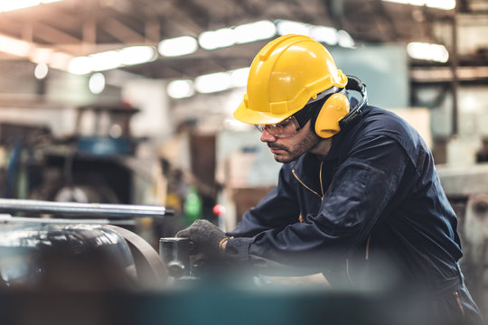 Industrial Engineers in Hard Hats.Work at the Heavy Industry Manufacturing Factory.industrial worker indoors in factory. man working in an industrial factory.