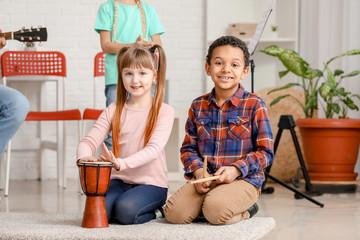 Cute little children at music school