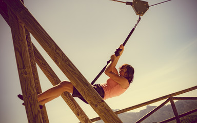 Adult woman having fun on zipline