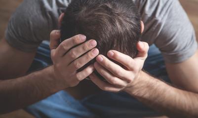 Fototapeta Caucasian depressed man at home. Mental health obraz