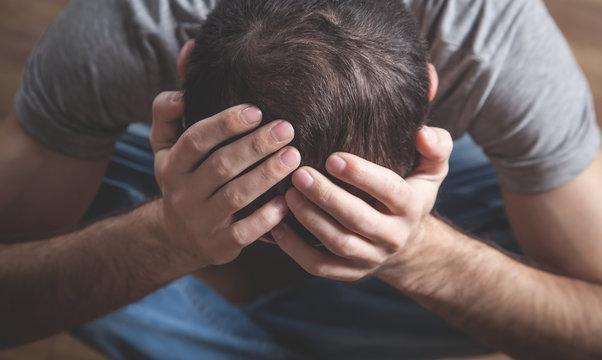 Caucasian depressed man at home. Mental health