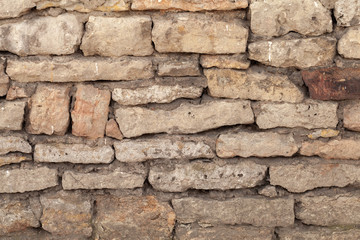 Fototapete - Old grungy wall made of rough stone blocks, texture