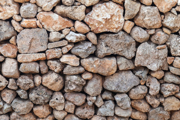 Fototapete - Old wall made of rough stones, background texture