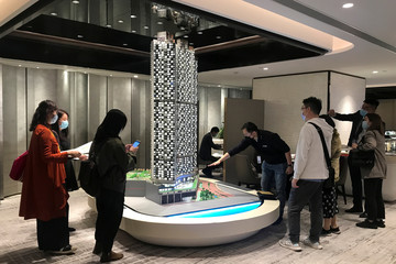People wearing face masks as a preventive measure against the novel coronavirus visit a salesroom of property developer Wheelock and Co, in Hong Kong