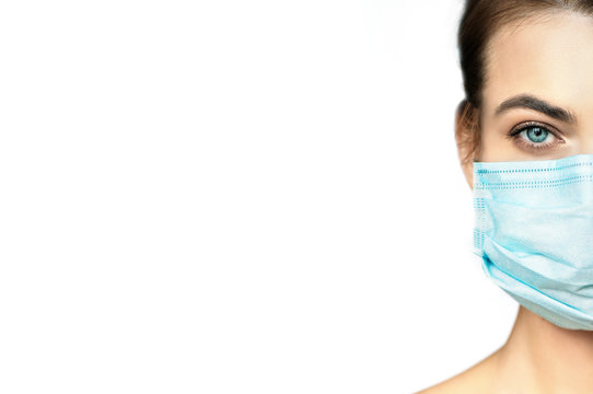 Partial view of young woman in protective medical mask with flowers on white background.